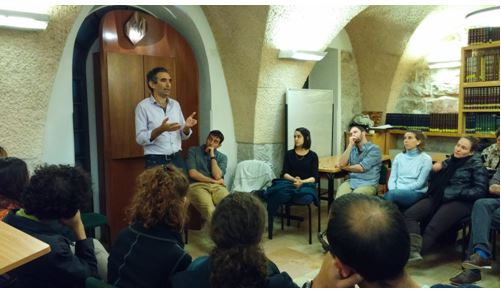 Photo:  Avi Dabush, a community organizer and activist, addresses two TAKUM cohorts at the Conservative Yeshiva in Jerusalem in March 2016.